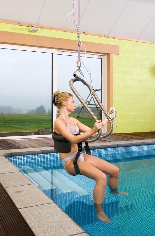 Into the pool with the SureHands® Body Support and ceiling motor